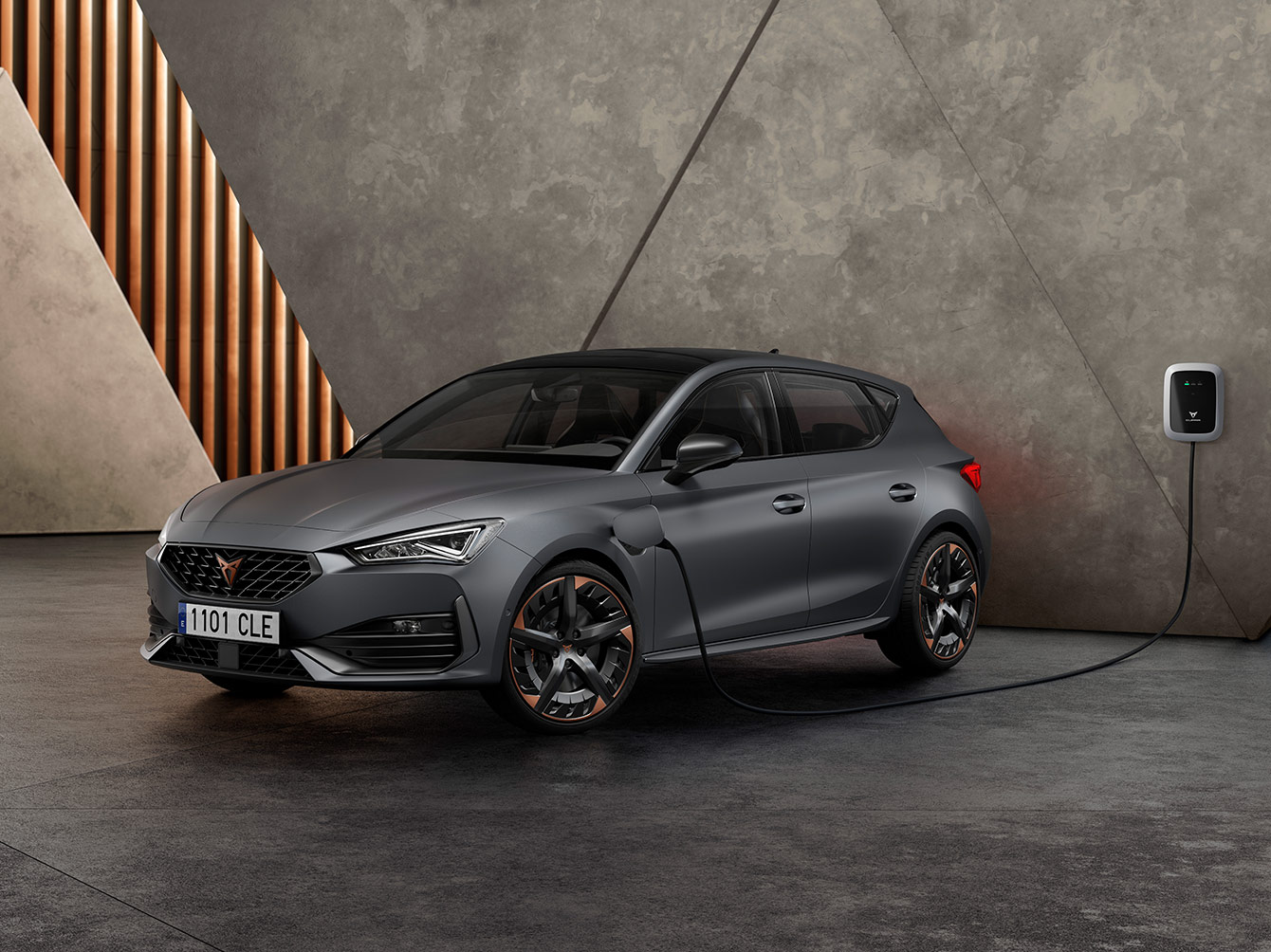 new-cupra-leon-ehybrid-five-door-magnetic-tech-matte-compact-sports-car-front-side-view-charging.jpg